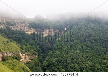 The cable car in the fog in summer