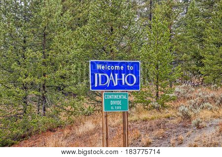 Signs for the Continental Divide and Welcome to Idaho