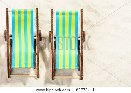 Two Sunbeds On The Beach: Top View