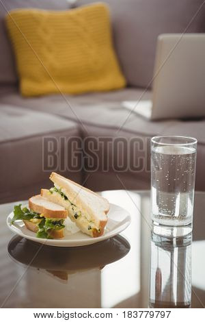 Close up of food in plate by drinking glass on table