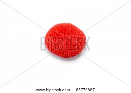 Close up of orange bath sponge against white background