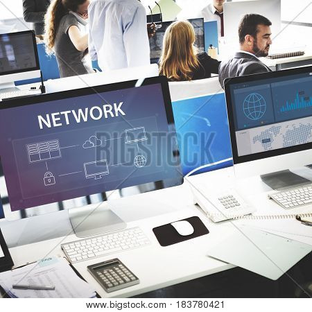 Group of people working on computer network graphic overlay