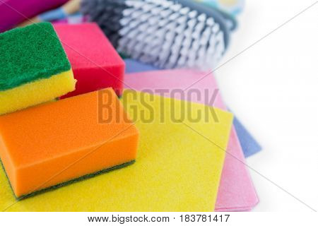Close up of wipe pads and sponges with brush on white background