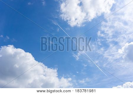 View on beautiful white clouds in a blue sky. Airplane in the sky. Clouds and Skies in the Morning. The Sun behind Clouds.  Fresh Air. Cloudy Weather. Cloud Formations. White Clouds