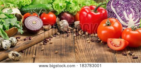Food different vegetables on the wooden table with copy space. Food background