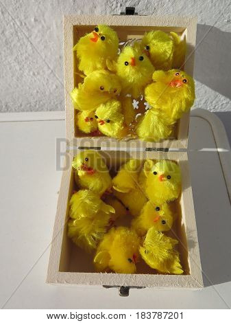 Box of Tiny yellow fluffy easter chicken decorations