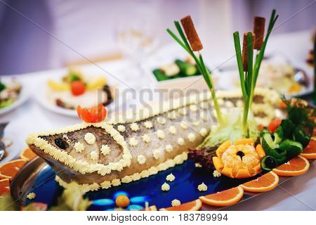 decorated fish served on a feast in a restaurant