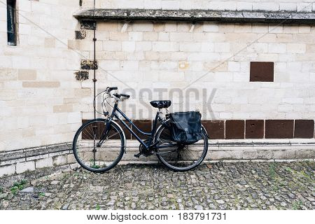 Leuven Belgium - July 30 2016: The Grand Beguinage of Leuven is a well preserved and completely restored historical quarter is owned by the University of Leuven and used as a campus. Bicycle parked
