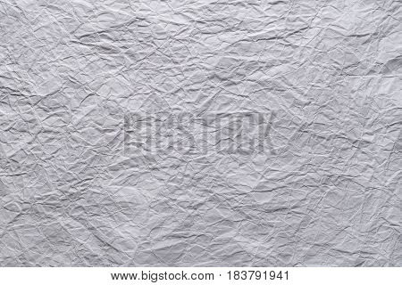 White crumpled sheet of paper textured background with copy space for text or image.