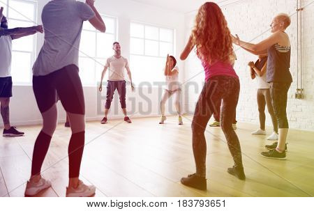 People standing in a circle in yoga class