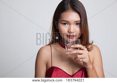 Young Asian Woman With A Glass Of Drinking Water.
