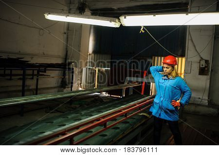 Woman In Red Safety Helmet At Metal Tile Roof Manufacturing Factory