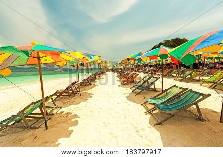 Colorful chairs and umbrella on tropical beach at Koh Khai Nok Island.Phuket Province.Thailand