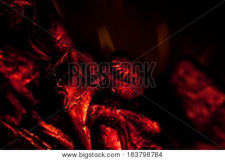 Close up of red smoldering wood for background