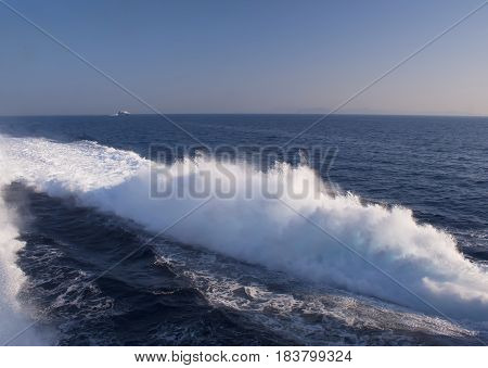 wave from the recently held boat in the ocean