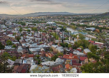 View over Tbilisi bird's-eye view in the rays of the evening sun