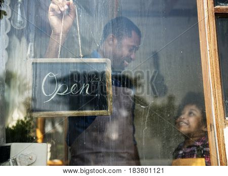 Father and Kid Hanging Open Sign