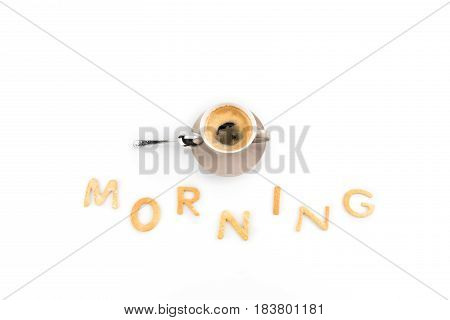 Cup Of Espresso Coffee For Breakfast With Cookies In Shape Of Morning Word Isolated On White