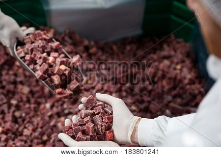 Close-up of pile of meat cube at meat factory