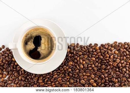 Cup Of Espresso Coffee With Coffee Beans Isolated On White With Copy Space