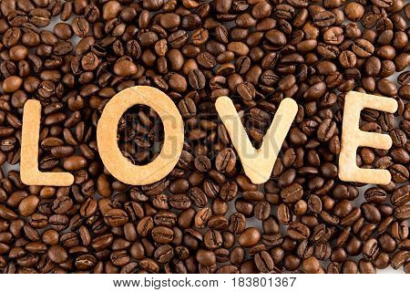 Coffee Beans With Cookies In Shape Of Love Word