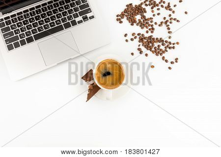 Top View Of Laptop, Cup Of Fresh Coffee And Coffee Beans Isolated On White