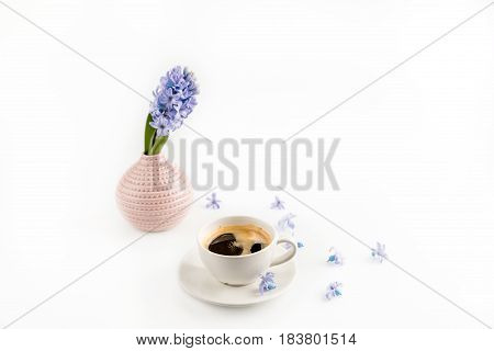 Close-up View Of Coffee Mug And Blue Hyacinth Flowers In Vase