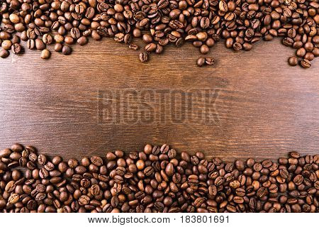 Top View Of Roasted Coffee Beans On Wooden Tabletop