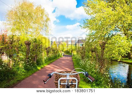 Bicycle and bicycle path. View from the seat of the bicycle. Cycling bicycling bicycle tourism concepts.