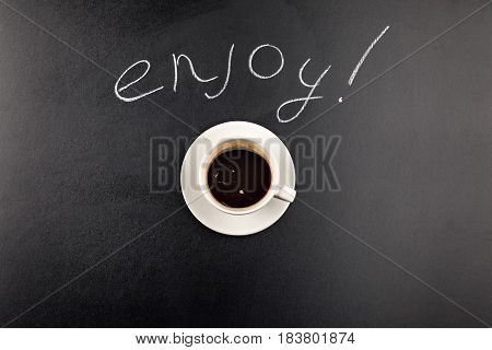 Top View Of Coffee Mug Steam And Enjoy Lettering Isolated On Black
