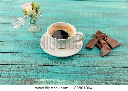 Coffee Mug Steam, Chocolate And Flowers In Vase On Table