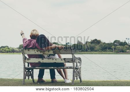 Lover fall in love together on the old long chair