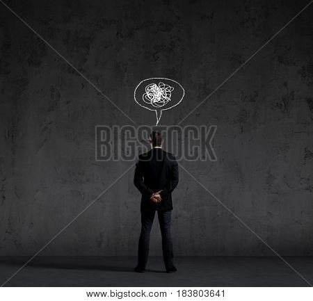Businessman standing over dark dramatic background. Business and office, concept.