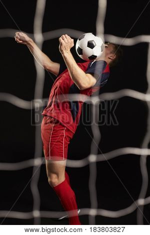 Professional Soccer Player Controlling Ball In Studio
