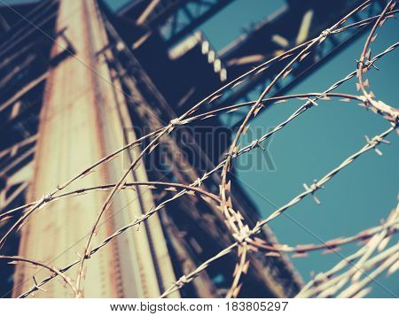 Industrial Concept Image Of Barbed Wire Around A Shipbuilding Crane