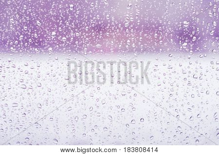 Rain Drops And Frozen Water On Window Glass Background, Purple Toning