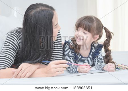 Happy Loving Family Mother And Her Daughter Child Girl Play In Children Room. Funny Mom And Lovely C