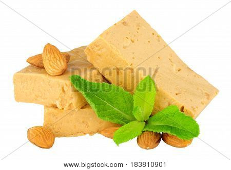 Soft nougat candy portions with almonds isolated on a white background