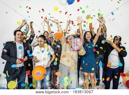 Group of Diverse People with Party Balloons Confetti