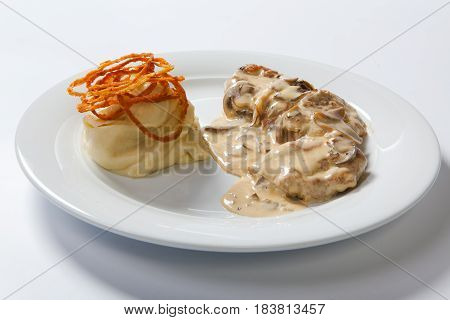 Stewed Chicken With White Mashed Potato And Mashroom Sauce