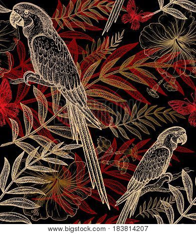 Exotic plants and birds parrots. Vector seamless floral pattern. Hand drawing of wildlife. Illustration - template for luxury fabric paper. Gold and red branch leaves flowers on black background.