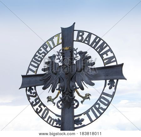 ZUGSPITZE AUSTRIA - August 15 2016: Famous symbol on top of huge mountain Zugspitze in Austria