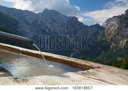 Rural scenery with wooden water well.Achensee Lake area Austria Tirol.