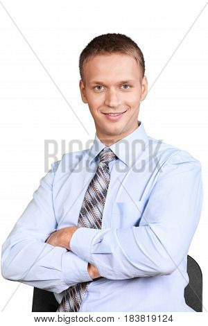 Businessman Sitting in a Chair with Arms Folded - Isolated