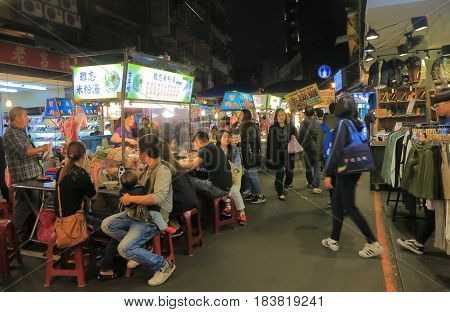 TAIPEI TAIWAN - DECEMBER 7, 2016: Unidentified people visit Song Shan Raohe Night market. Raohe Night market is one of the oldest night markets in Taipei.