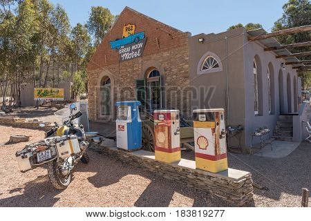 BARRYDALE SOUTH AFRICA - MARCH 25 2017: A motorcycle and historic fuel dispensers in front of a motel in Barrydale a small town on the scenic Route 62 in the Western Cape Province