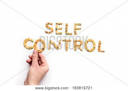Top View Of Self Control Lettering Made From Sweets And Hand Holding Letter, Healthy Living Concept