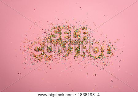 Top View Of Self Control Lettering Made From Sweets Isolated On Pink, Healthy Living Concept