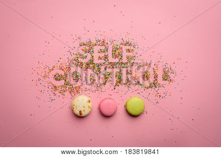 Top View Of Self Control Lettering Made From Candies Isolated On Pink, Healthy Living Concept