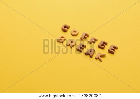 Coffee Break Lettering Made Of Crisps Isolated On Orange